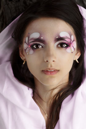 young attractive woman face flower makeup