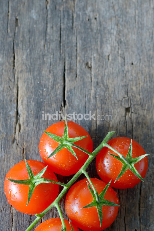 ripe cherry tomatoes on wood