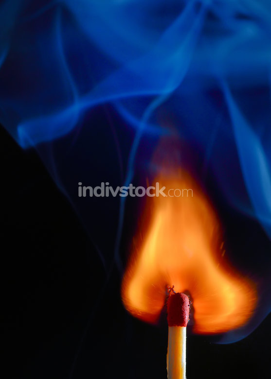 Burning match with blue smoke