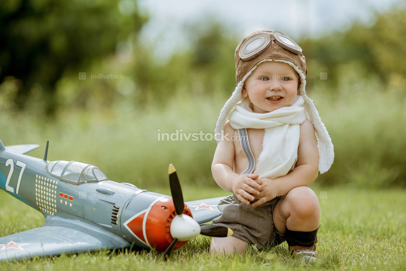Child pilot. Kid playing outdoors. Kid pilot with toy jetpack