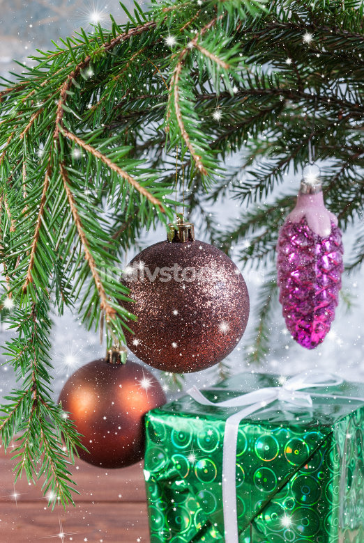 Christmas tree branch with Christmas balls and gift box
