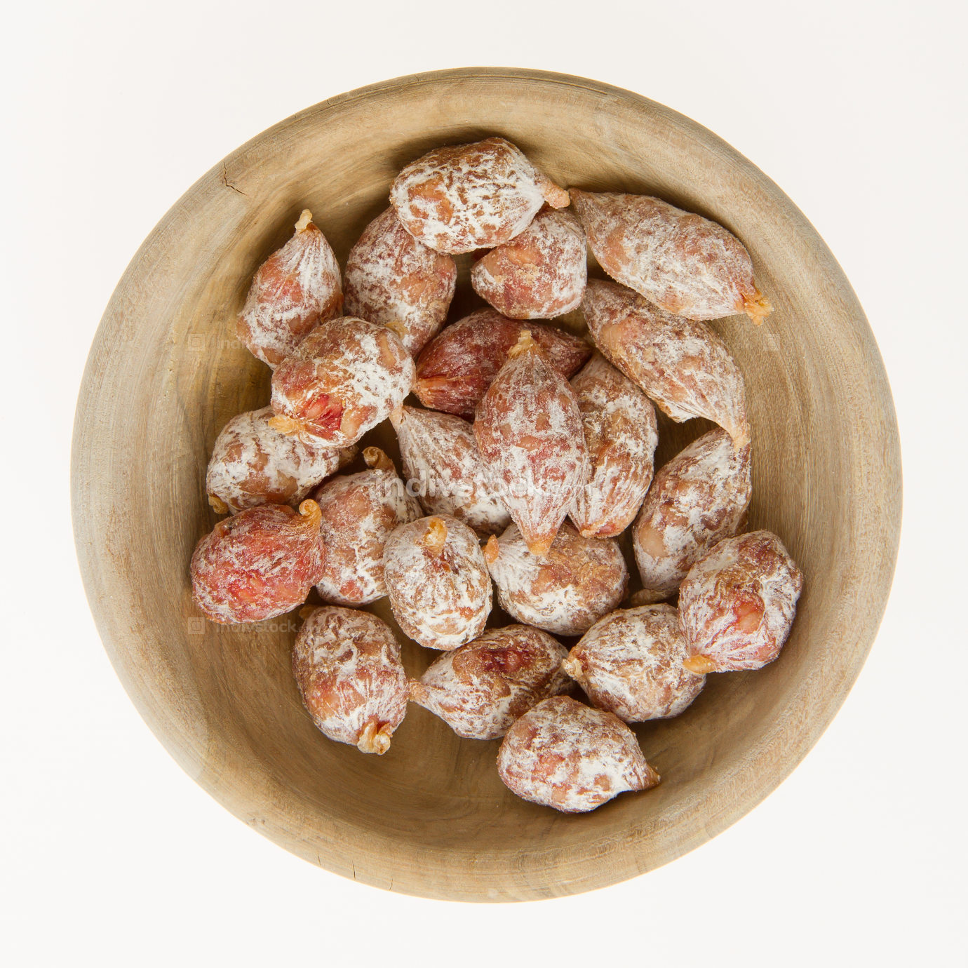 Close-up of salami of Italy in a wooden bowl