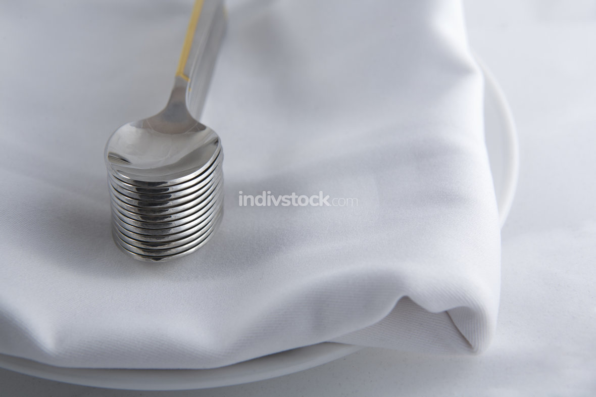 Dessert spoons over napkin