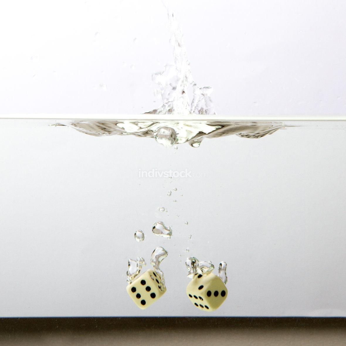 Dice with splashing water