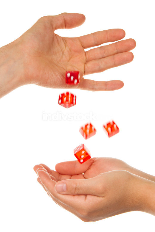 Five red dice being thrown from a hand