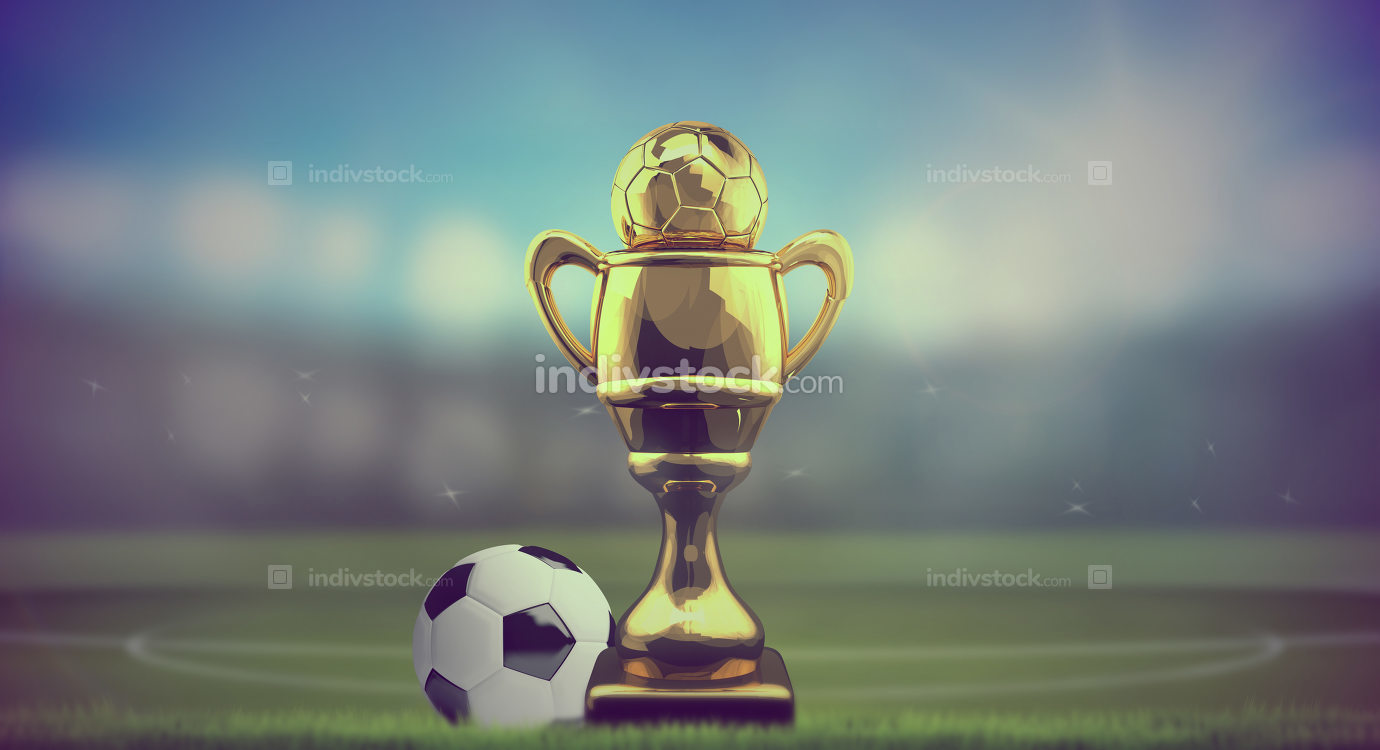 football golden cup and ball at soccer football stadium backgrou