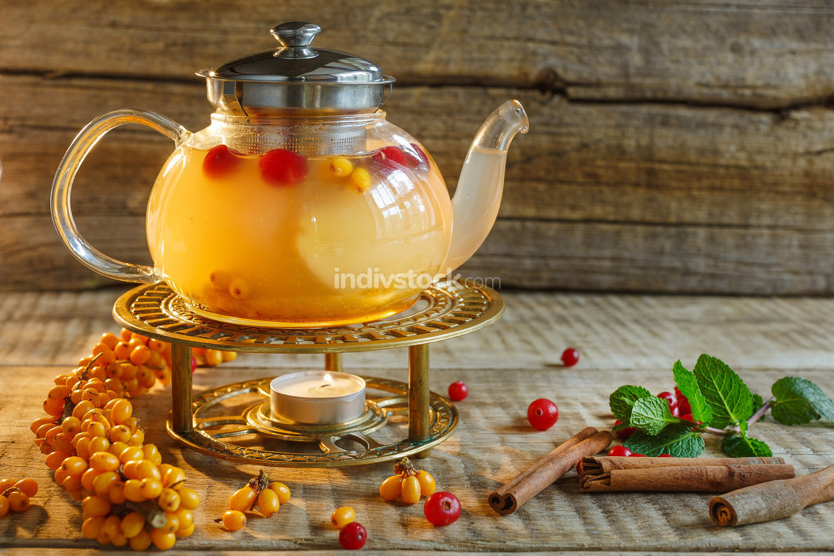 Glass tea pot with hot tasty tea