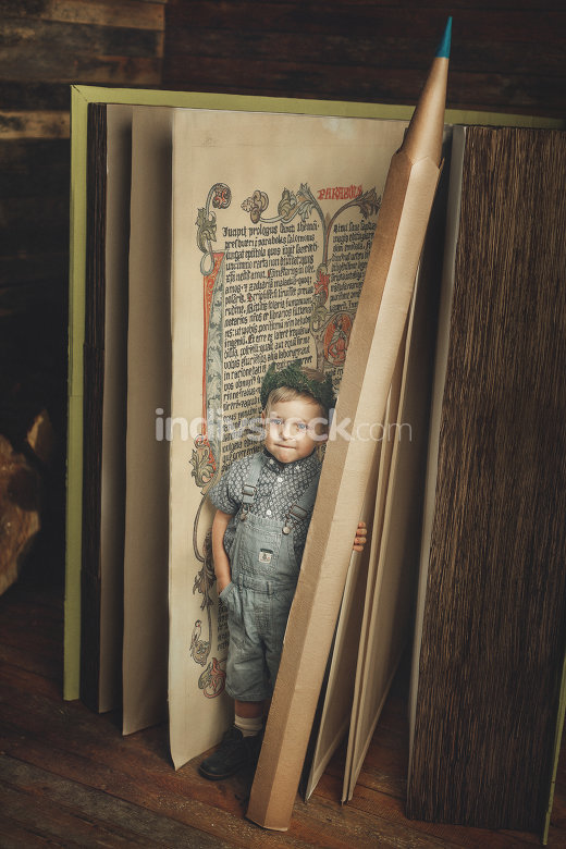 Little boy reading a book, study, knowledge symbol, bibliophile.