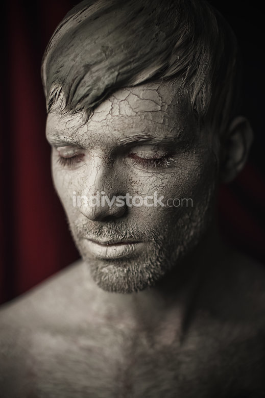 Man Face with Skin Covered in Mud