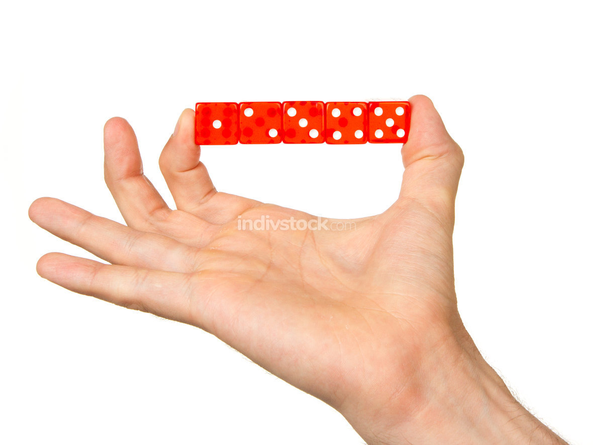 Man holding five red dice