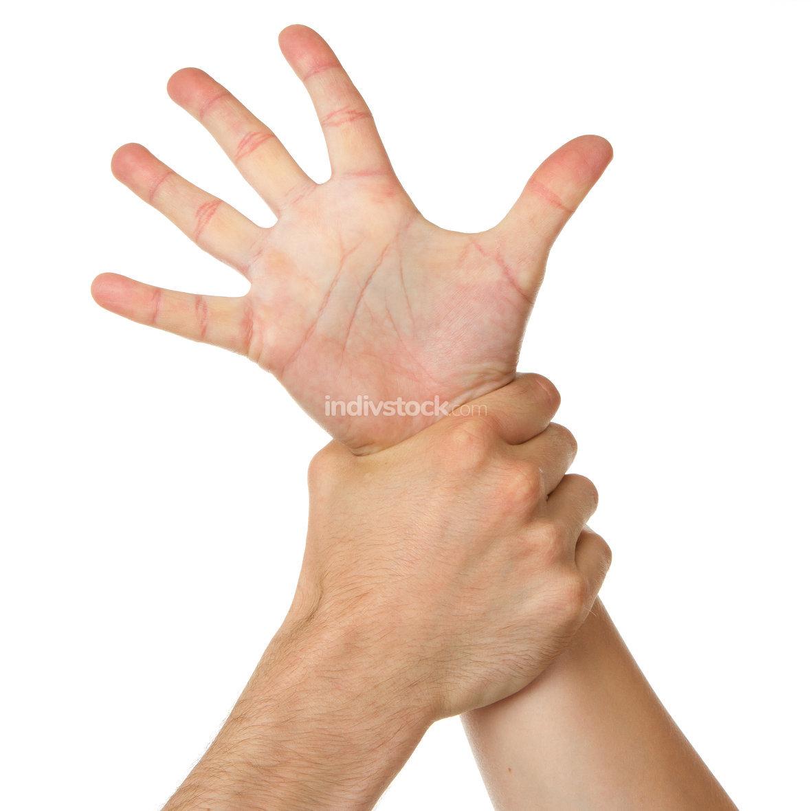 Man holding woman by wrist