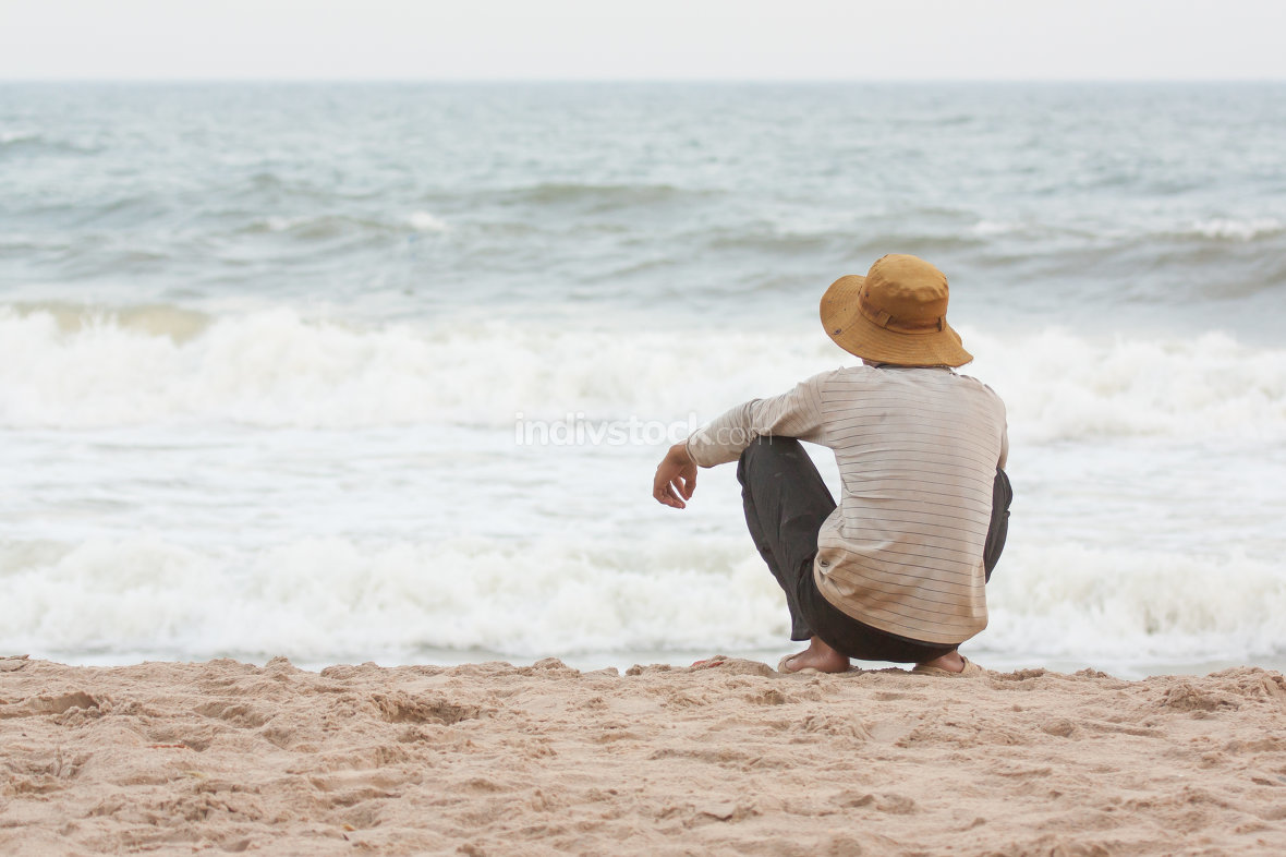 Man sitting on the beach at the south chinese sea