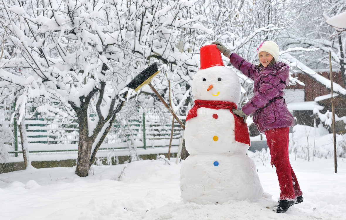 pending - model release - snowman and young girl