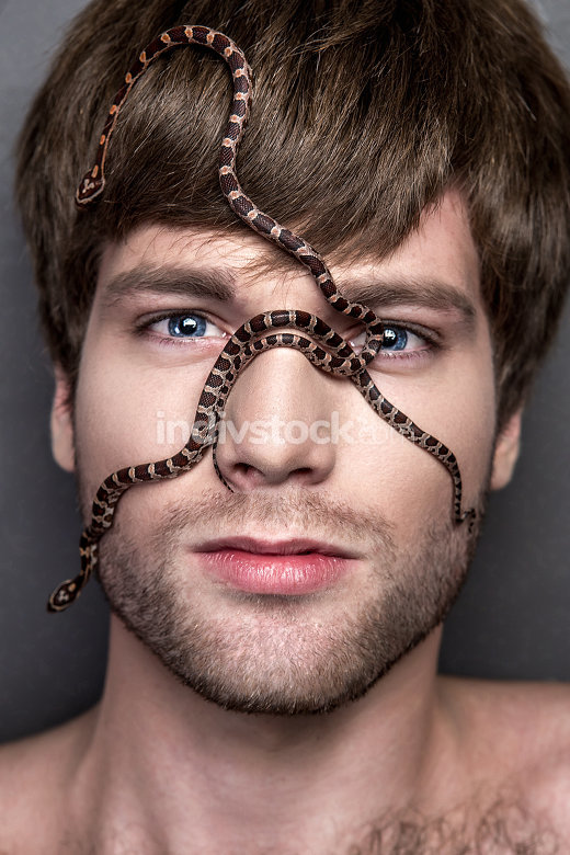 Portrait of a Young Handsome Man with Snake on His Face