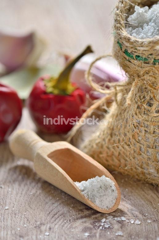Salt spoon on wooden background