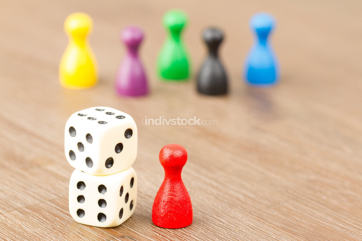 Six colored pawns and two dice