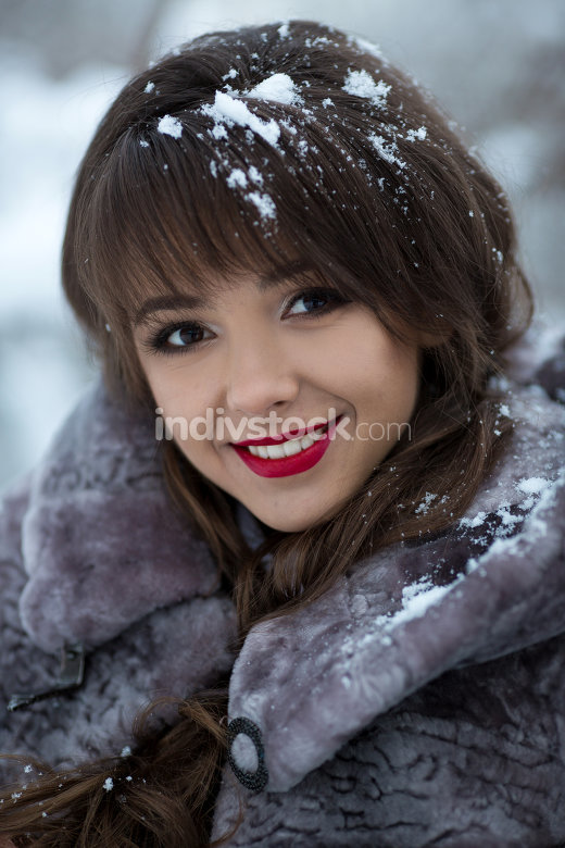 smiling woman outdoors in winter