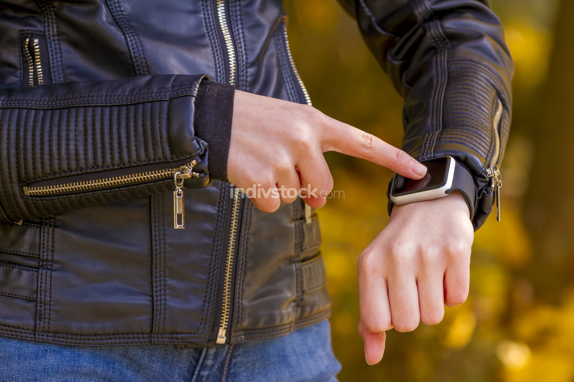 Teenager girl Using touchscreen smart watch