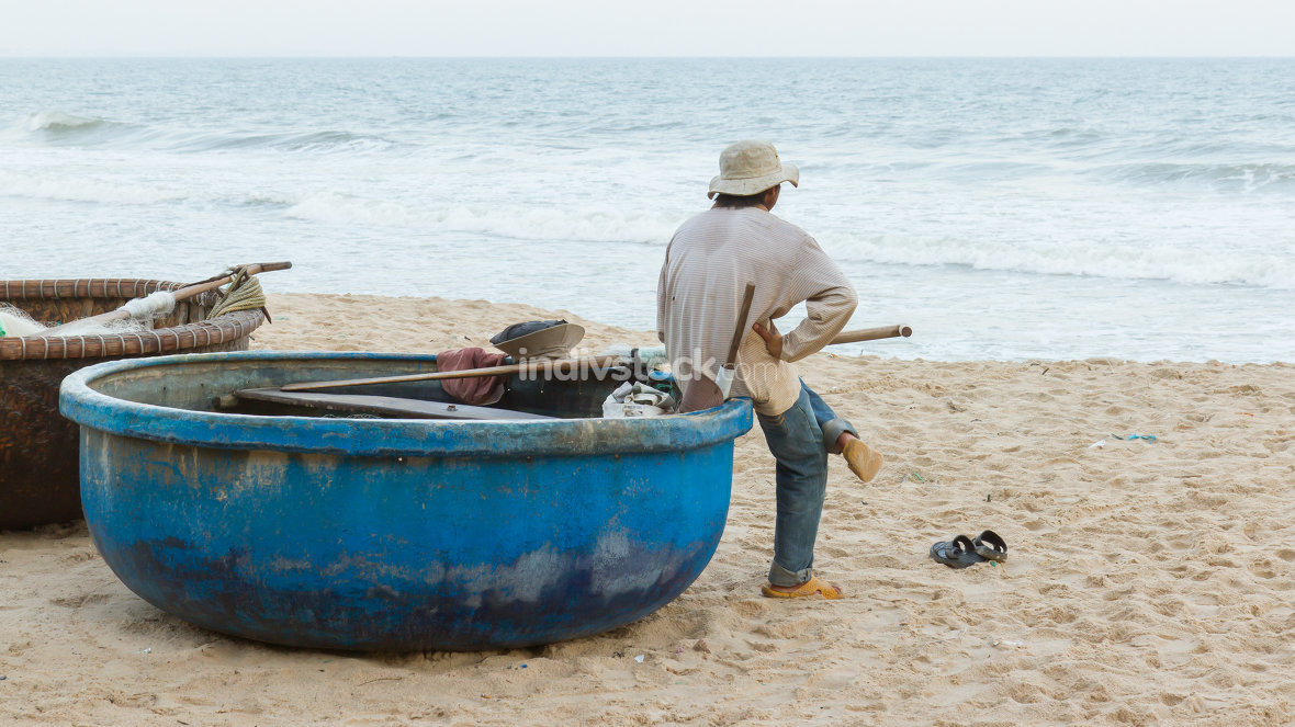 Unidentified man with Vietnamese fishing boat