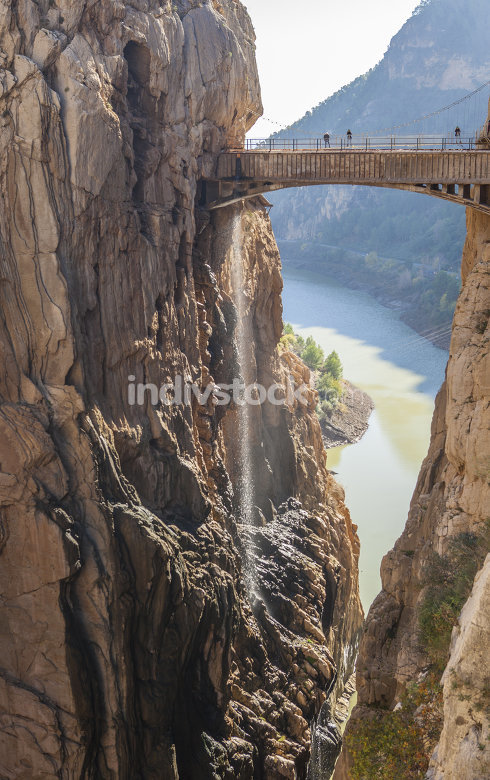 Visitors crossing the suspension bridge at Caminito del Rey Path