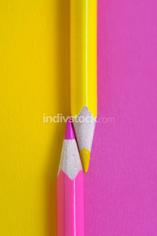 yellow and pink crayons