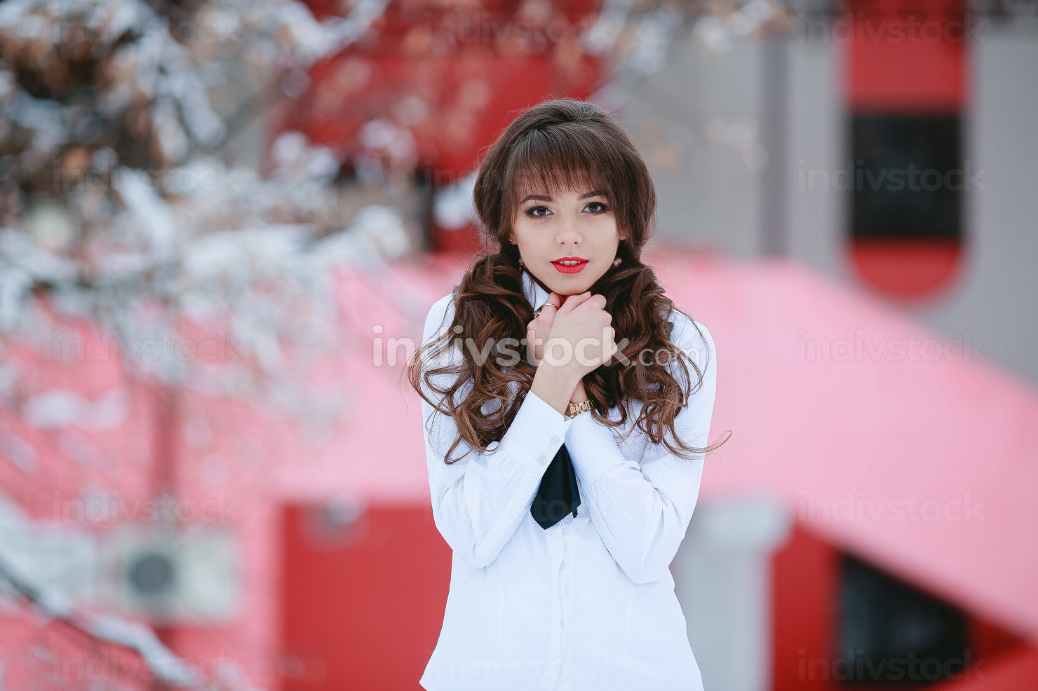 young woman outdoor and cold blurred background