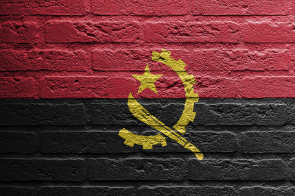 Brick wall with a painting of a flag,  Angola