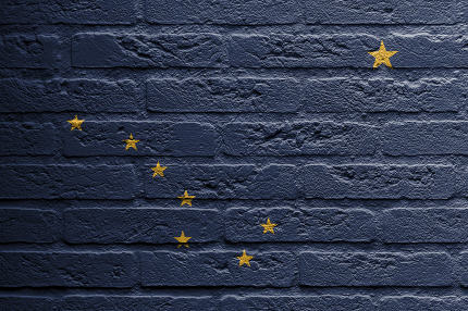 Brick wall with a painting of a flag, Alaska
