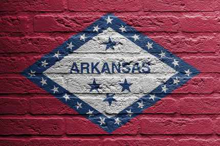 Brick wall with a painting of a flag, Arkansas