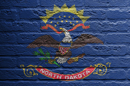 Brick wall with a painting of a flag, North Dakota