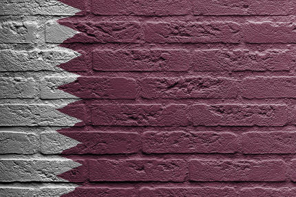 Brick wall with a painting of a flag, Qatar