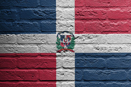 Brick wall with a painting of a flag, the dominican republic