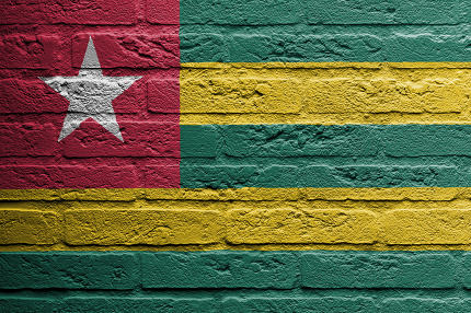 Brick wall with a painting of a flag, Togo