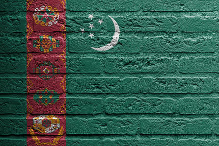 Brick wall with a painting of a flag, Turkmenistan
