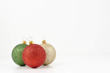 Gold, green and red Christmas balls isolated on white background