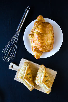 Homemade breads or bun on wood background, croissant puff and pi