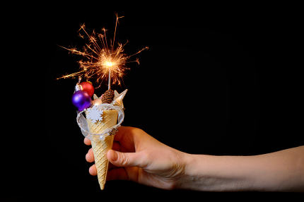 Ice cream cone and christmas decoration on black background