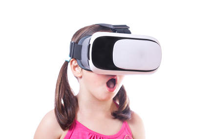 Little girl with virtual reality glasses