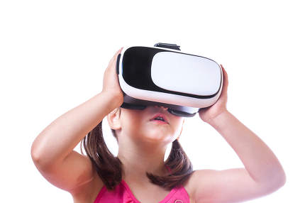 Little girl with VR glasses