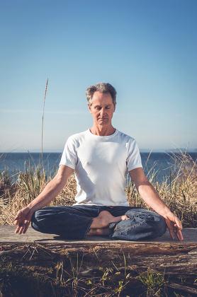 Man sitting in yoga pose.