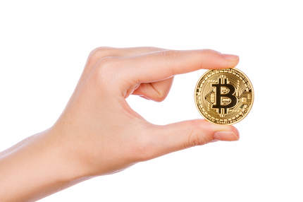 Young girl hand holding bitcoin on white