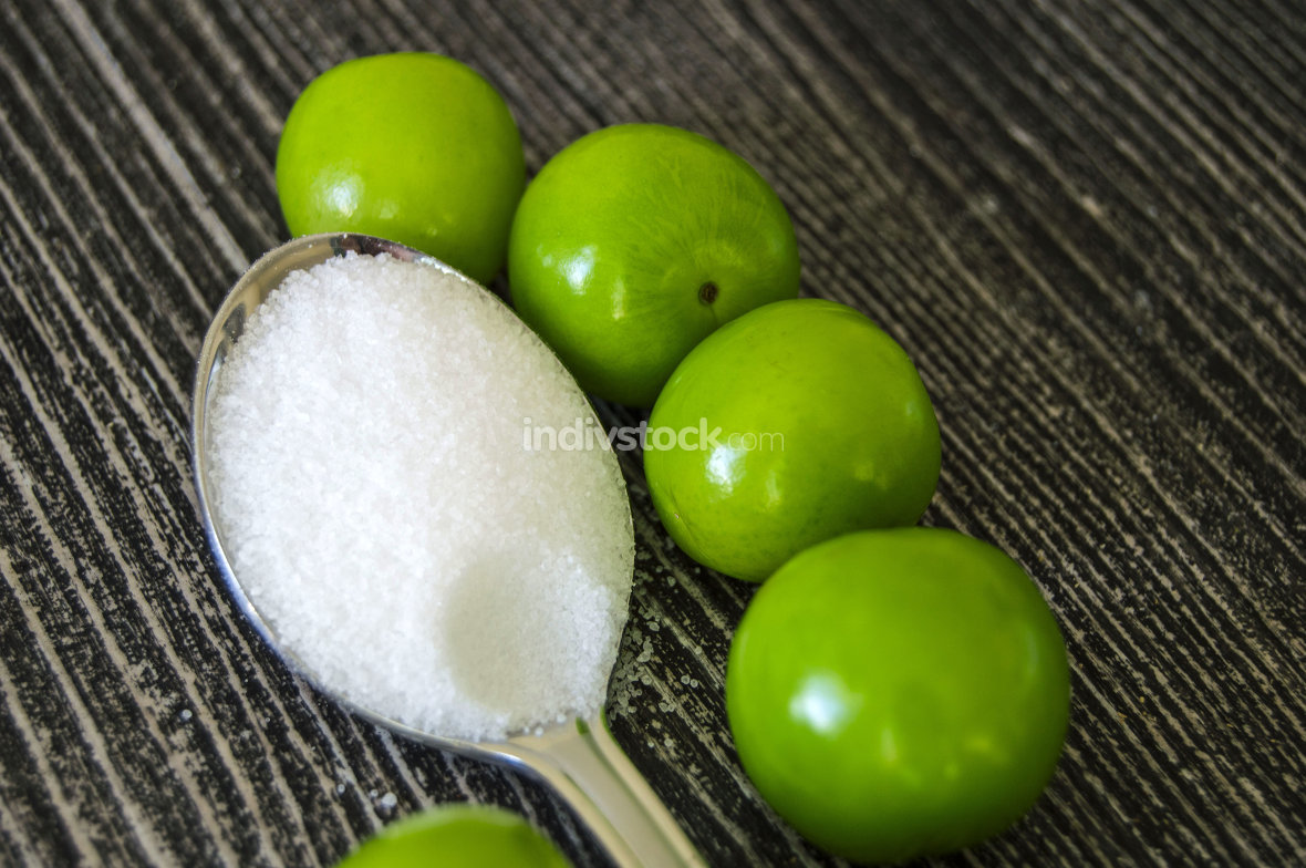 A handful of sour plums,  Salt and plum food is very tasty. There are a handful of sour plums,