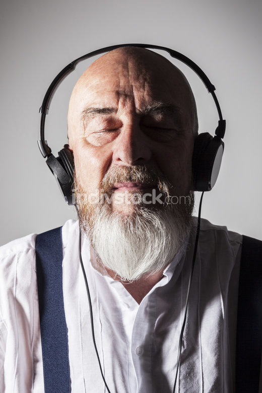 an old man listening to music