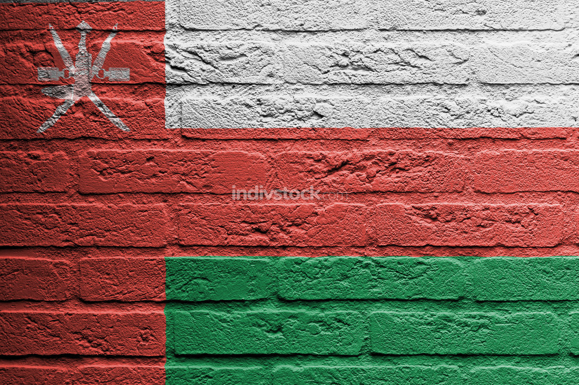 Brick wall with a painting of a flag, Oman