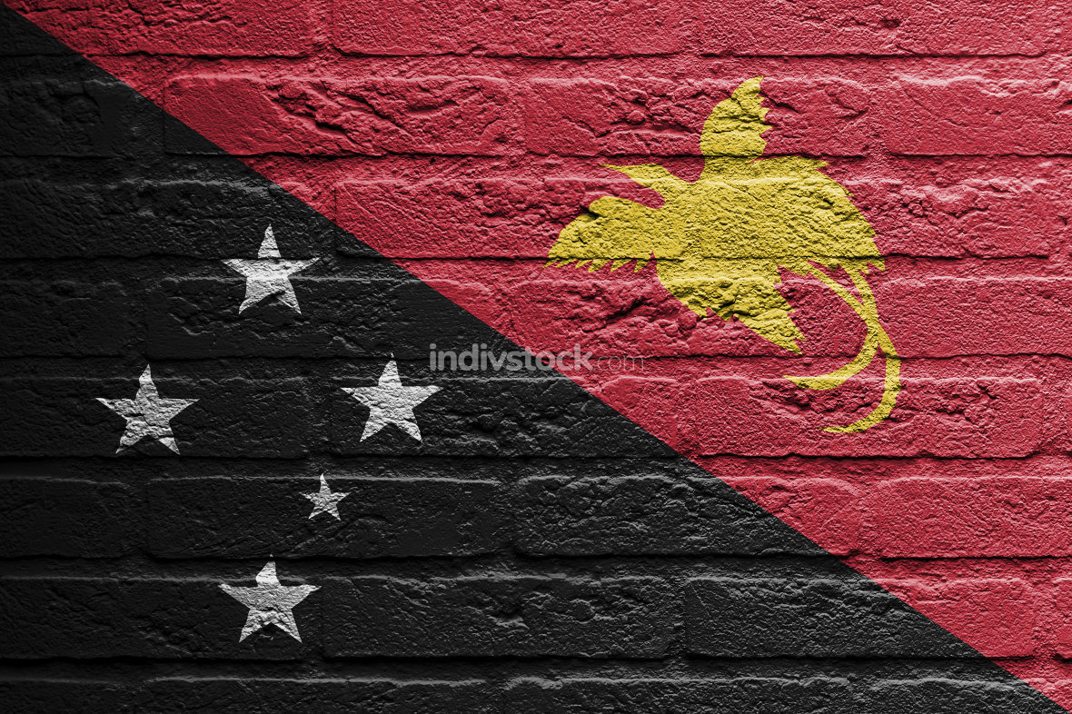 Brick wall with a painting of a flag, Papua New Guinea