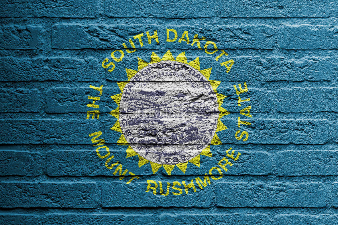 Brick wall with a painting of a flag, South Dakota
