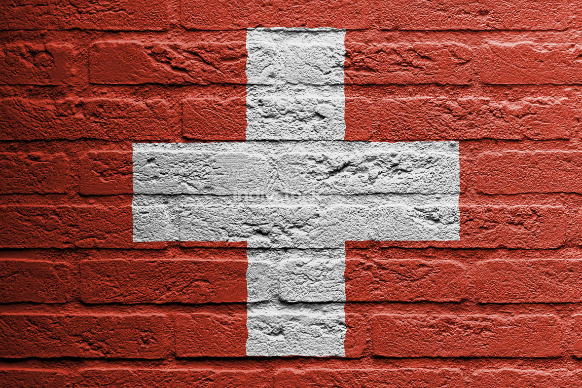 Brick wall with a painting of a flag, Switzerland