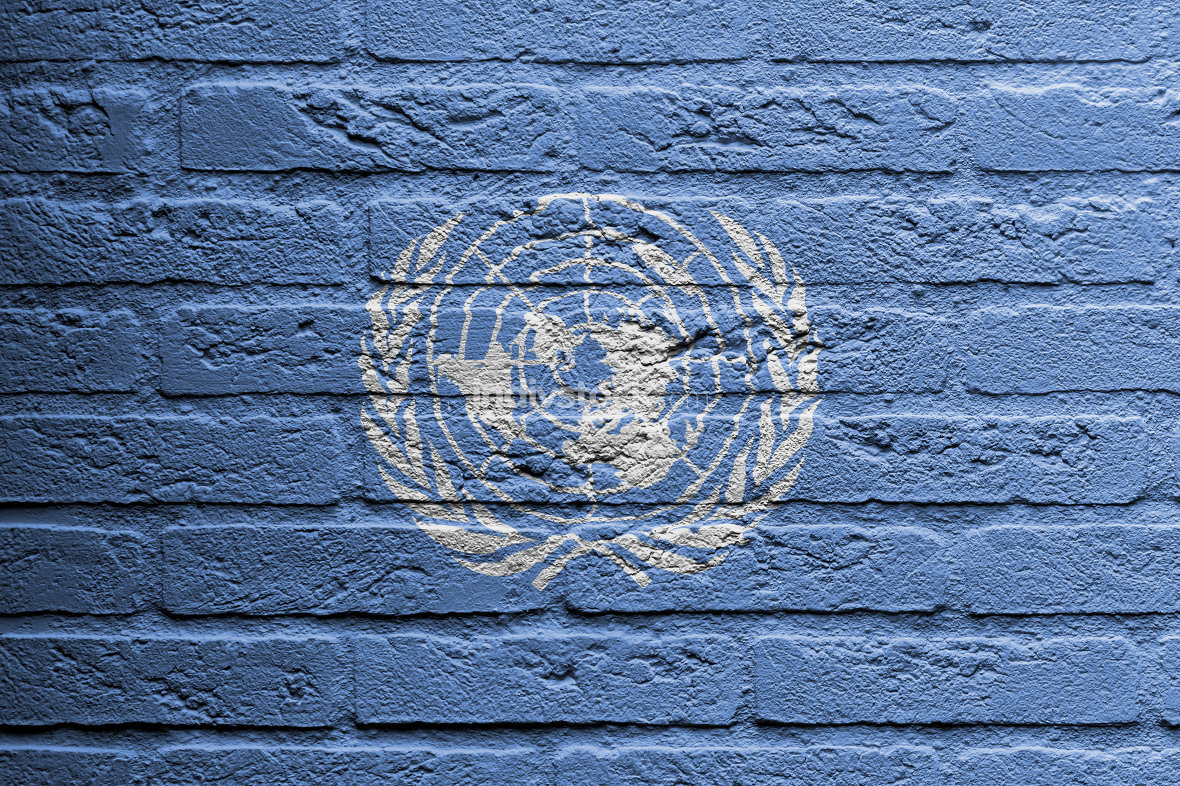 Brick wall with a painting of a flag, UN