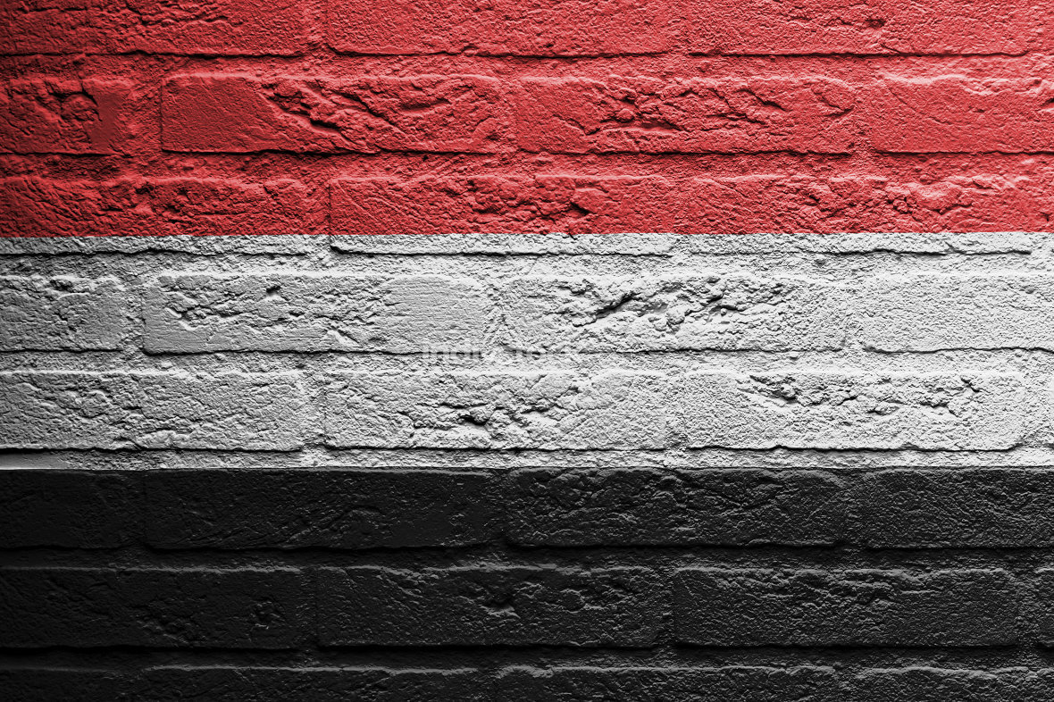 Brick wall with a painting of a flag, Yemen