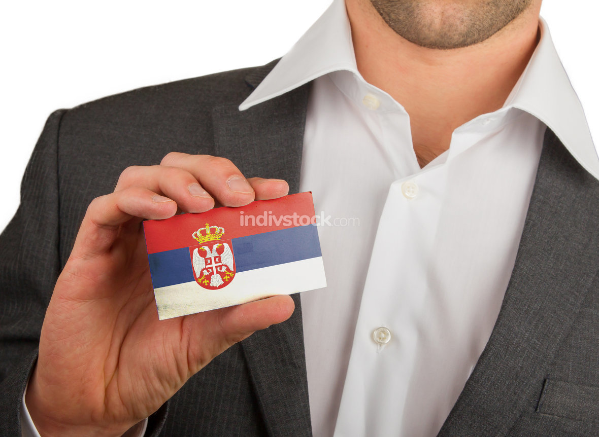 Businessman is holding a business card, Serbia